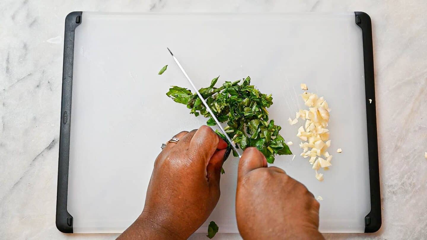Chopping garlic and basil