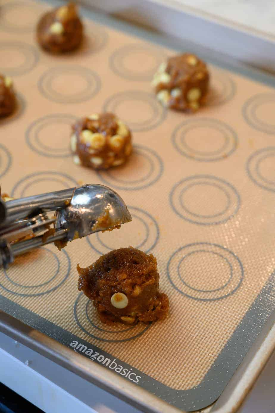 white chocolate macadamia nut cookie balls with cookie scoop