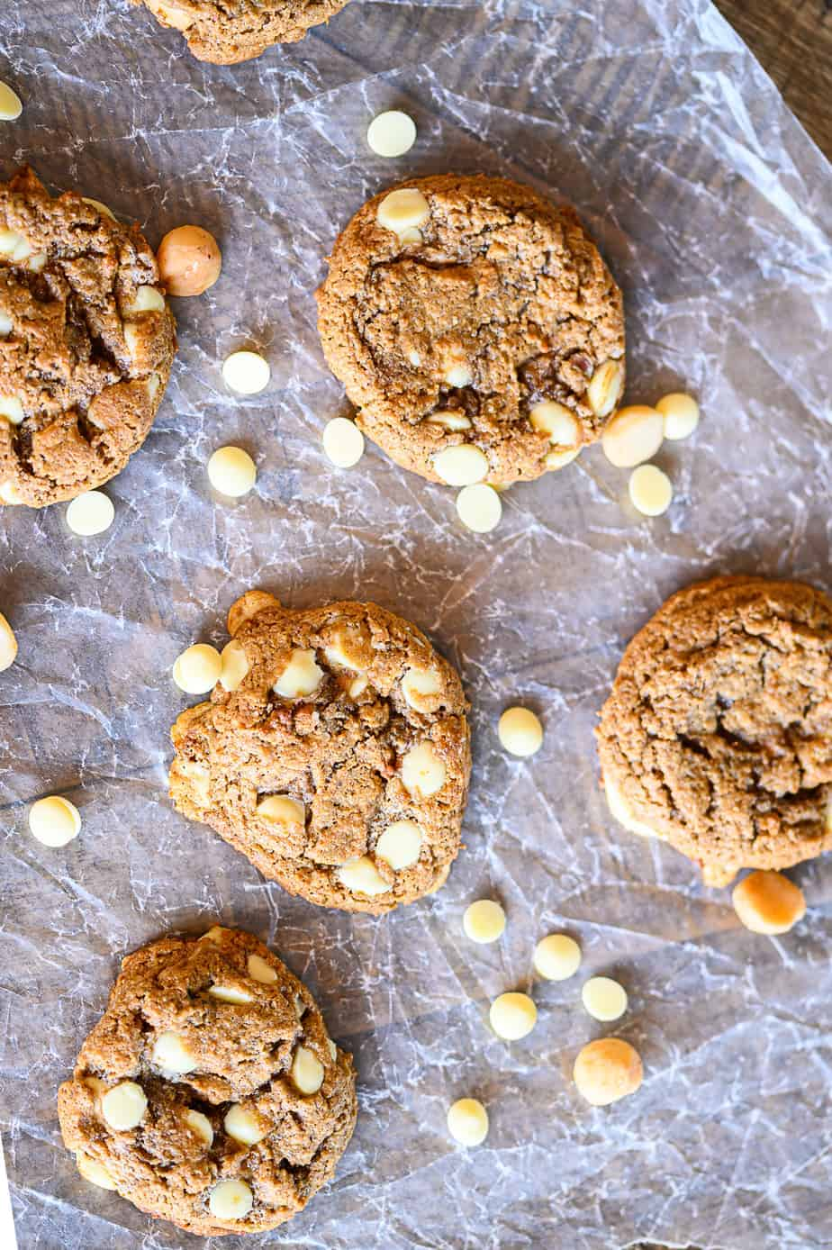 white chocolate macadamia nut cookies on wax paper