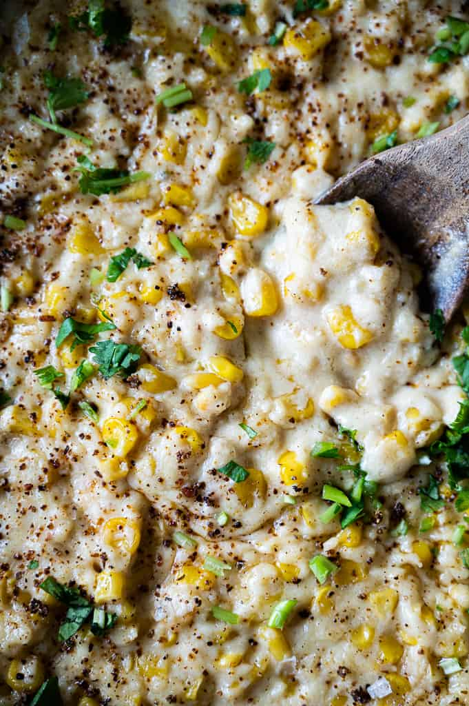 Elote in pan with a spoon