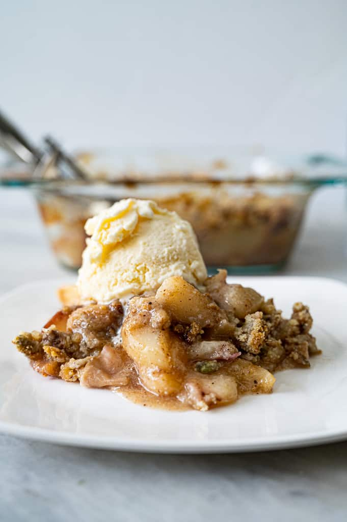 Peach crumble with ice cream on top