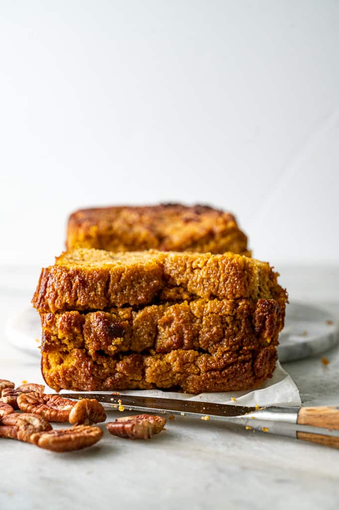 Keto pumpkin bread stacked on top of each other.