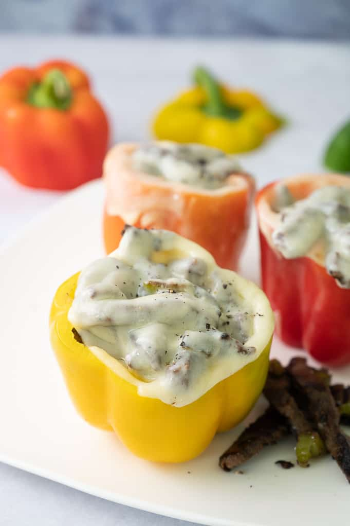 Yellow bell pepper with provolone cheese on top.