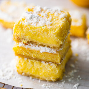 lemon bars stacked on top of each other