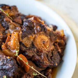 Jamaican oxtail in a bowl close up