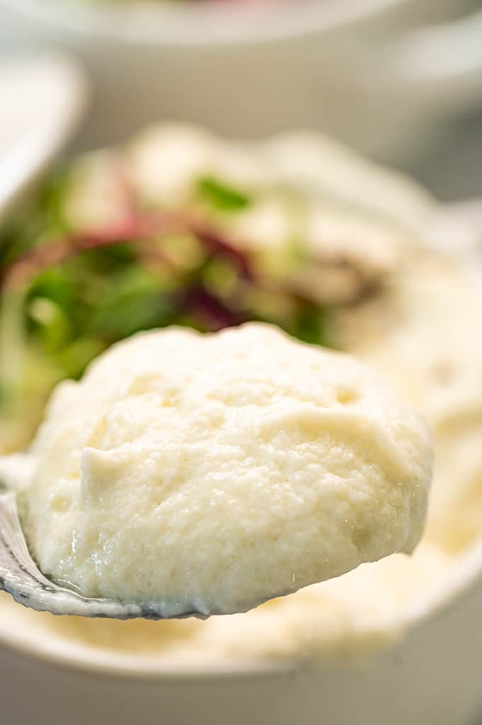 pureed cauliflower on a spoon