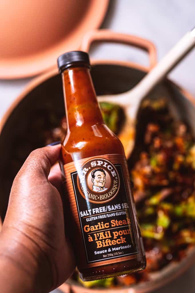 Mr. Spice Garlic Steak Sauce Bottle held in hand
