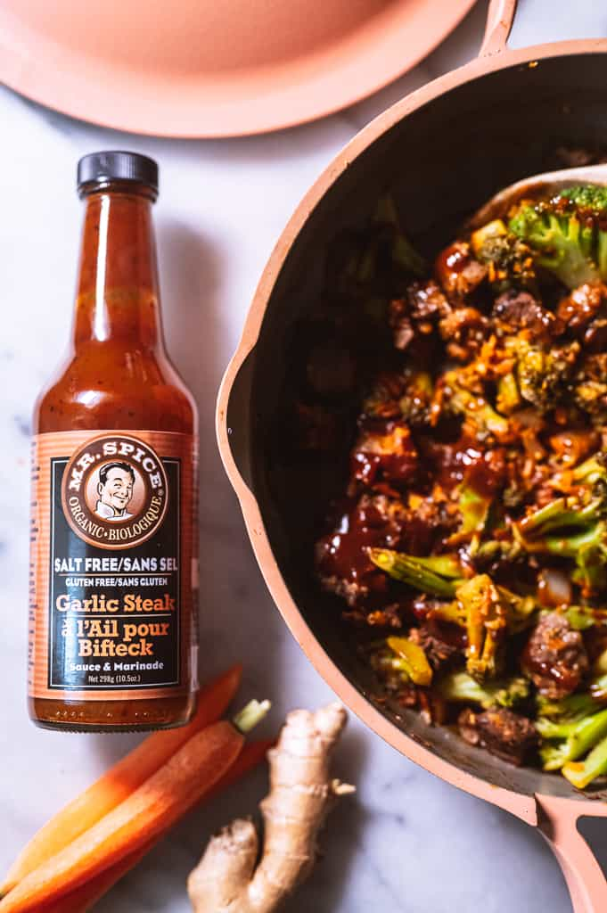 Mr. Spice bottle next to pan of beef and broccoli