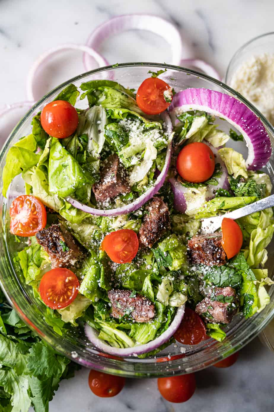 Fajita steak salad with onion and tomatoes in a bowl