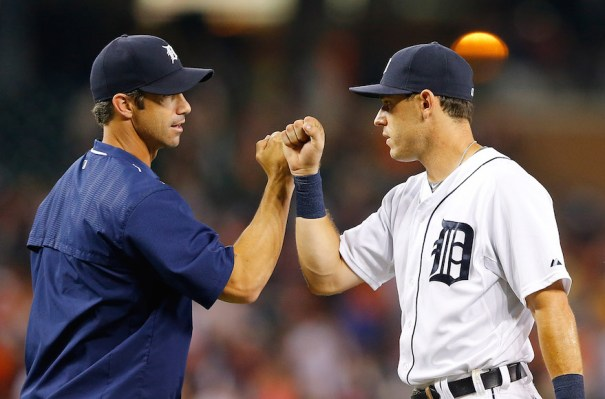 DETROIT, MI - JULY 20: Manager Brad Ausmus #7 of the Detroit Tigers celebrates a win over the Seattle Mariners with Ian Kinsler #3 on July 20, 2015 at Comerica Park in Detroit, Michigan. The Tigers defeated the Mariners 5-4. (Photo by Leon Halip/Getty Images)