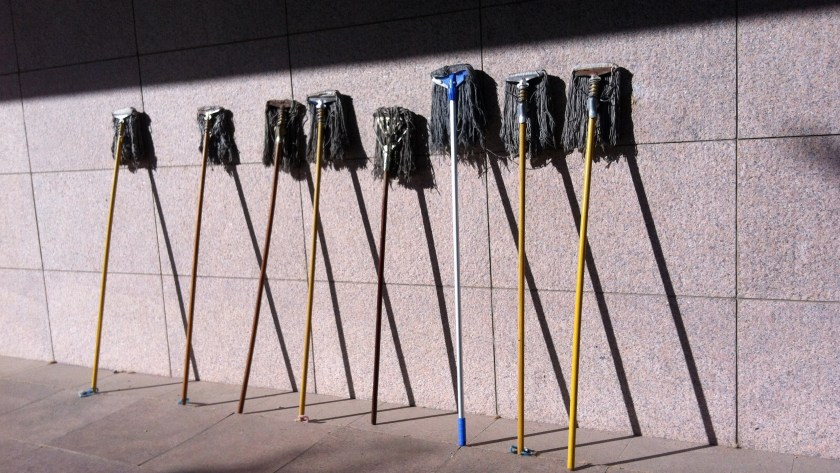 A squadron of mops beside the academy's library.