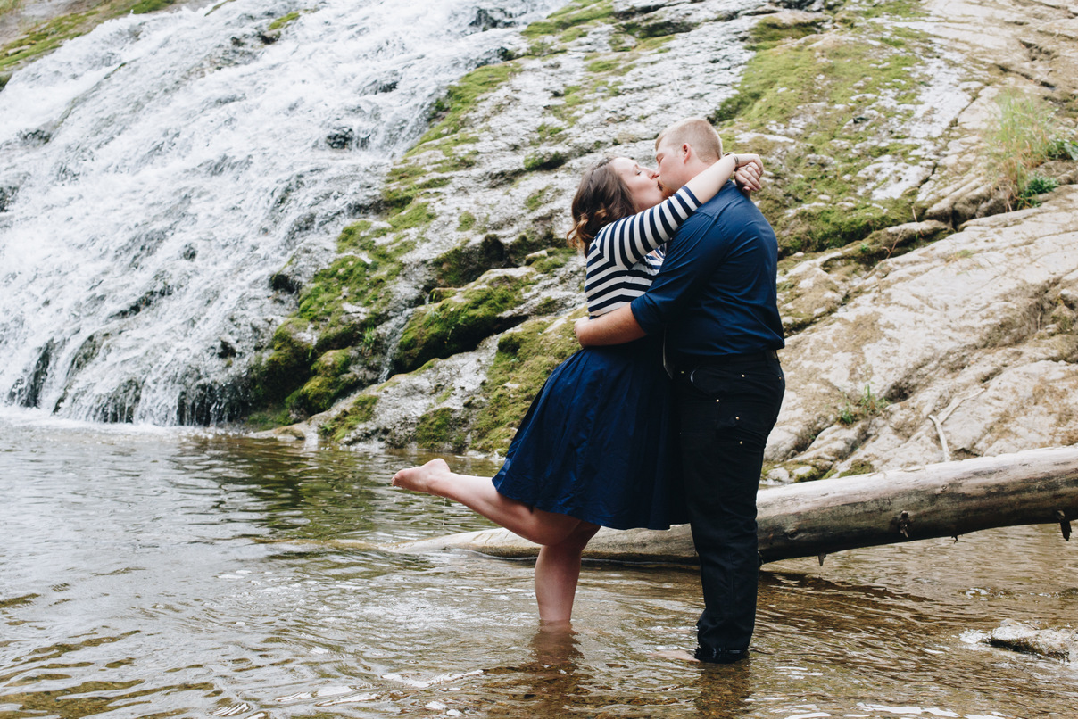 kissing by a waterfall