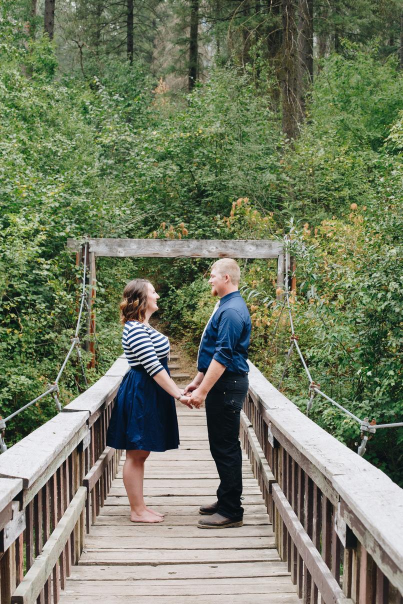 couple on bridge, engagement session