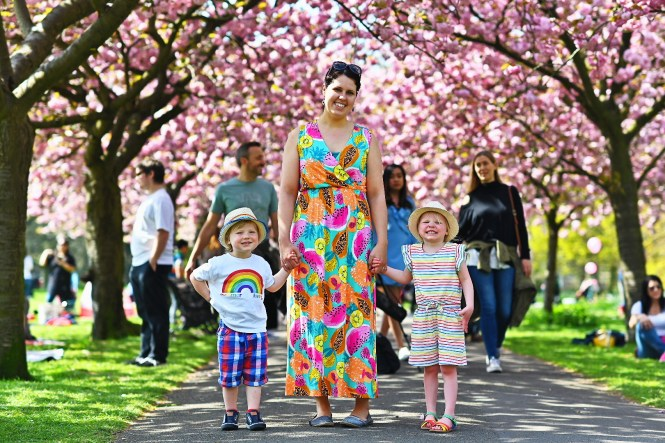 mum and twins in cherry blossom