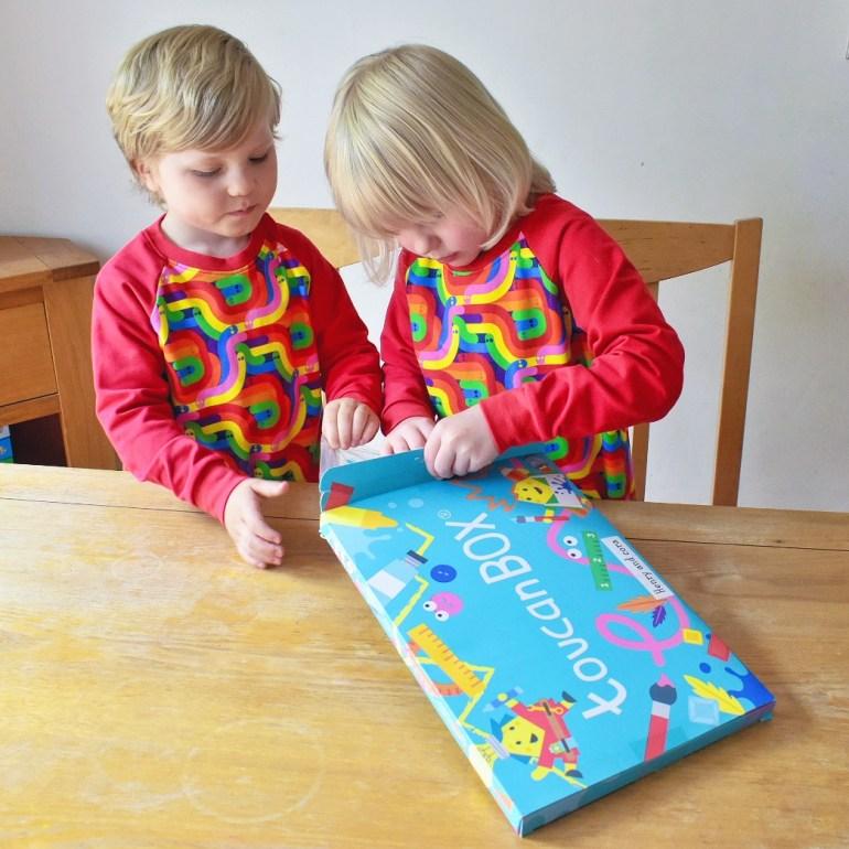 Twins opening craft box