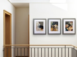 Hannah Brown paint palettes framed and displayed in a modern home