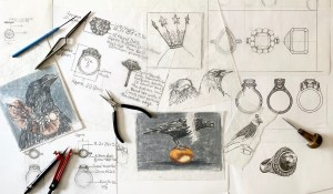 jewelry sketches by Dallas, Texas artist Hannah Brown laid out on a table with jewelers tools