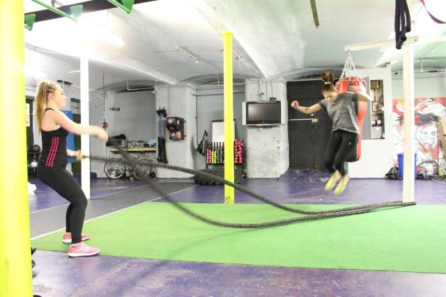 girls doing rope jumping in gym green floor
