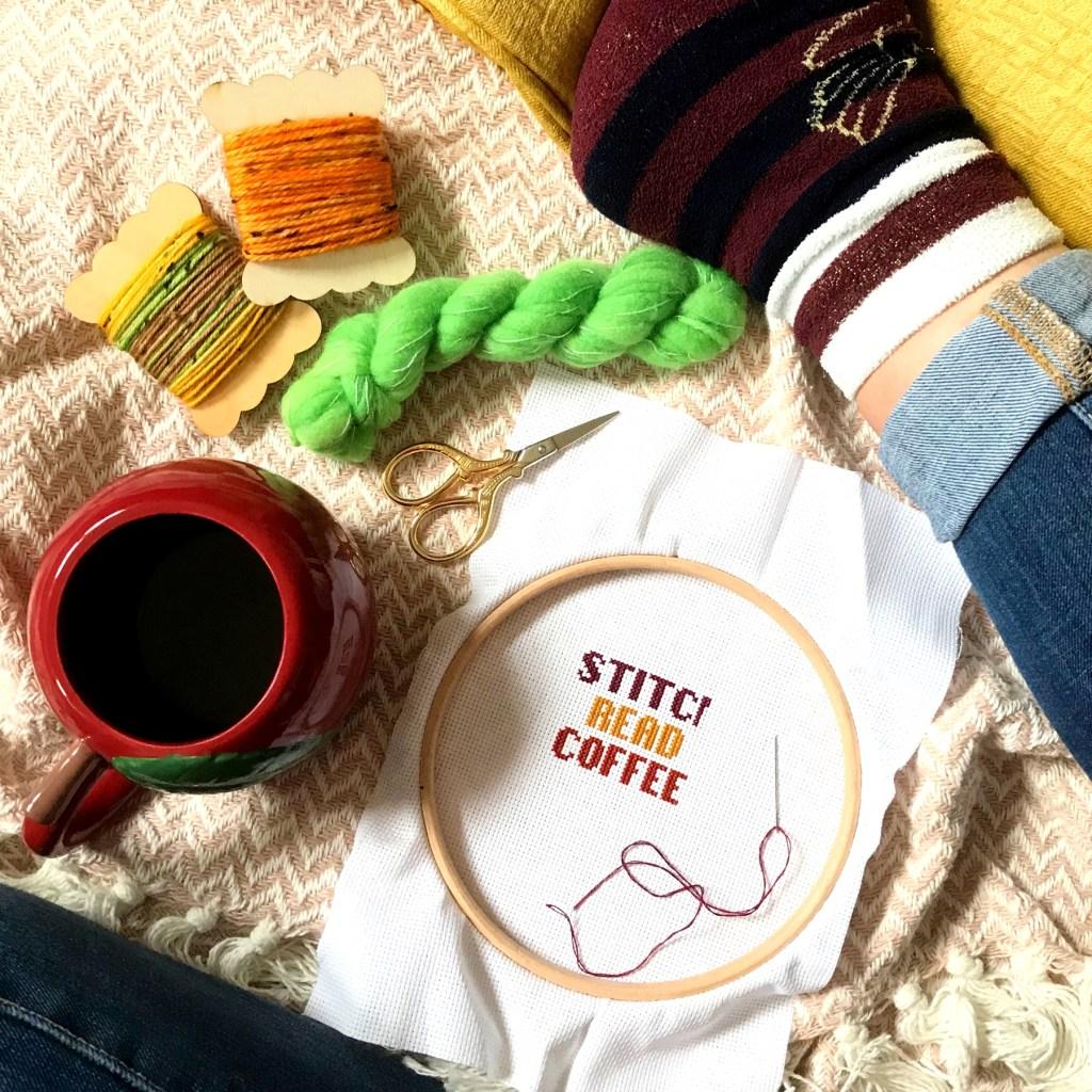 cross stitch coffee and yarn flat lay
