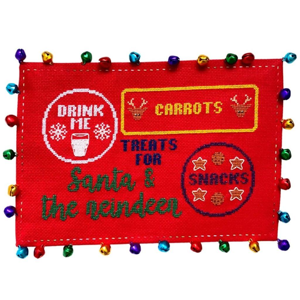 cross stitch christmas mat with bells