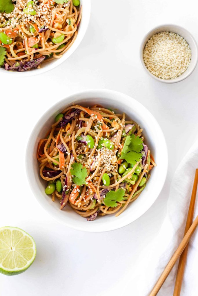 This vegan Asian Noodle Salad with Spicy Peanut Dressing is packed with flavour + protein and fibre to keep you full. Perfect as a side dish or lunch throughout the week!