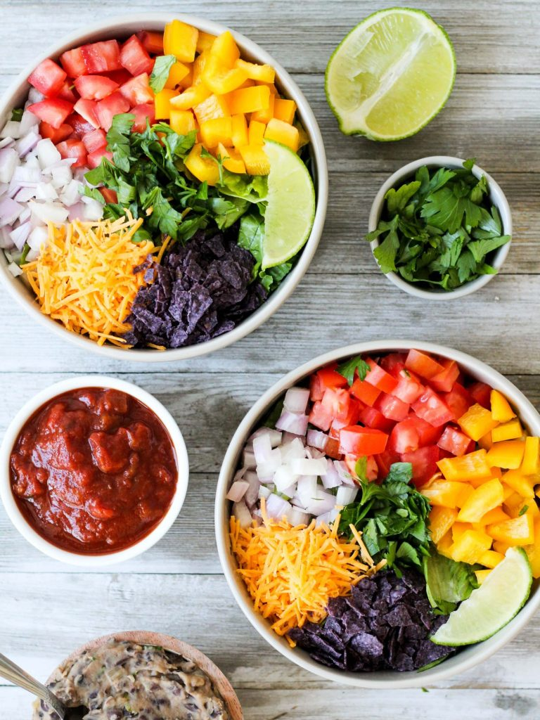 These vegetarian taco salads make a super quick dinner or packed lunch. They're perfect for meal-prep or when you just don't want to spend a ton of time cooking. Gluten-free, packed with tons of healthy veggies, and can easily be made vegan without the cheese.