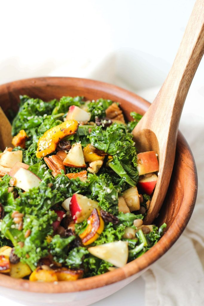 This Autumn Kale Salad features is super delicious and is made with super healthy ingredients! A great, vegan + gluten-free fall and winter recipe to meal prep!