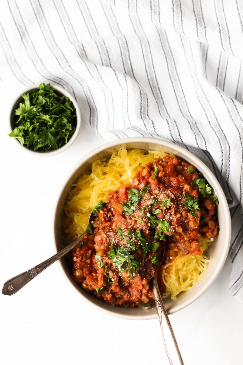 This easy lentil bolognese with spaghetti squash is a great healthy comfort food dish. Made with a handful of simple ingredients and gluten-free + vegetarian/vegan!