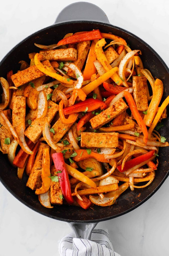 Add these Easy Tofu Fajitas to your list of quick and healthy meals to try! This plant-based recipe takes 30 minutes to make and is packed with protein and nutritious vegetables.
