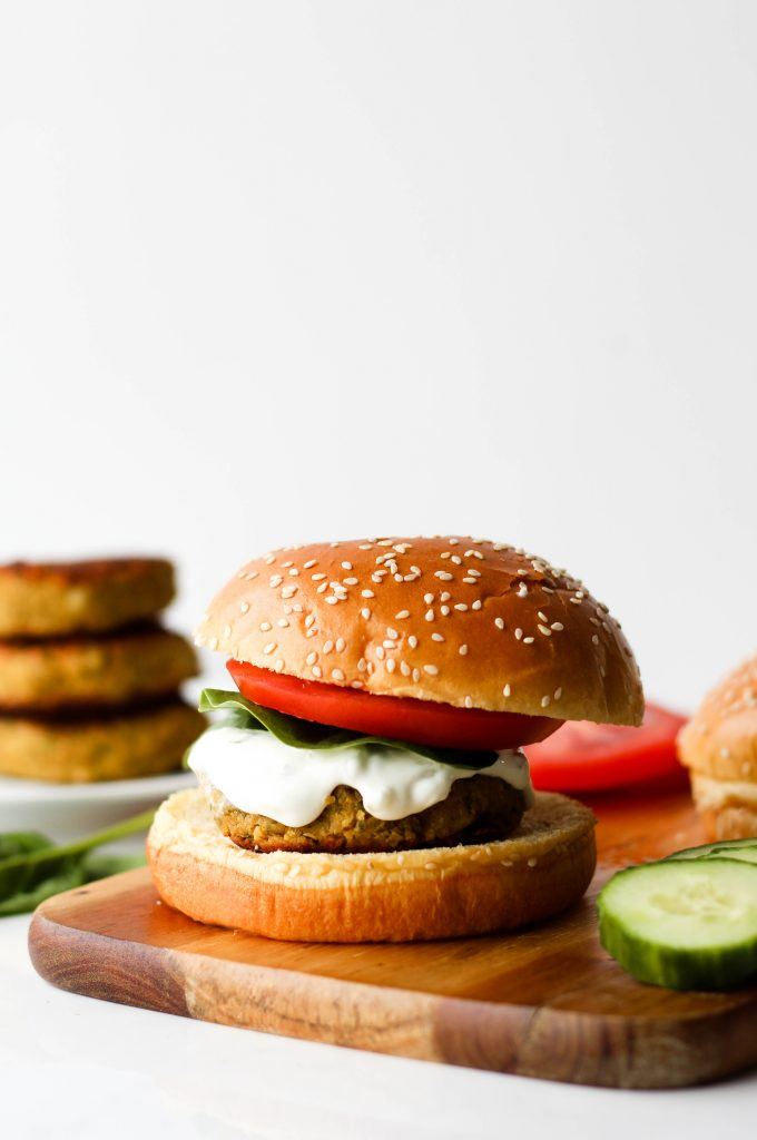These Greek Chickpea Burgers are everything you need in a plant-based burger. They're healthy, flavourful and delicious with creamy tzatziki sauce.