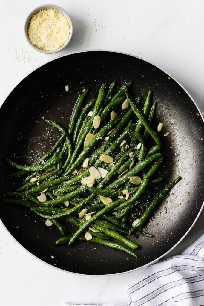 These garlic green beans are a delicious, easy and healthy side dish for any meal. All you need is a few simple ingredients and less than 15 minutes to make them!