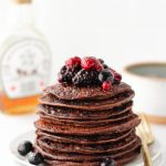 Make these easy Chocolate Protein Pancakes in a flash! Blend ingredients together, cook, then enjoy for a high-protein healthy breakfast. This recipe is perfect for meal-prep. Store leftover pancakes in the fridge or freezer and reheat as needed!