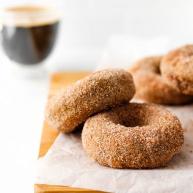 These dairy free donuts with cinnamon sugar are totally vegan and easy to make. Bake them at home and enjoy with your favourite coffee or warm beverage for a sweet treat.