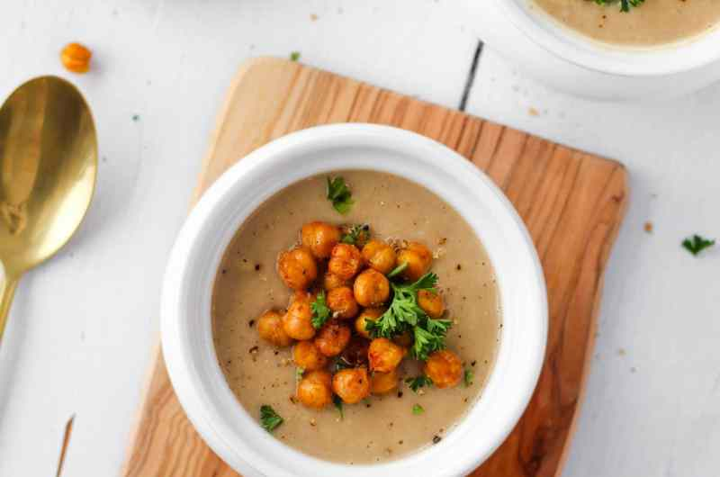 This Vegan Roasted Cauliflower Soup is easy to make and so deliciously creamy. It's also packed with plant-based protein and fibre thanks to a secret ingredient: white kidney beans!