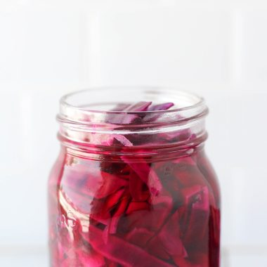 This Quick Pickled Red Cabbage is so easy to make and so tasty! You're going to want to eat it on everything. It's a great addition to salads, tacos, nourish bowls, sandwiches and more.