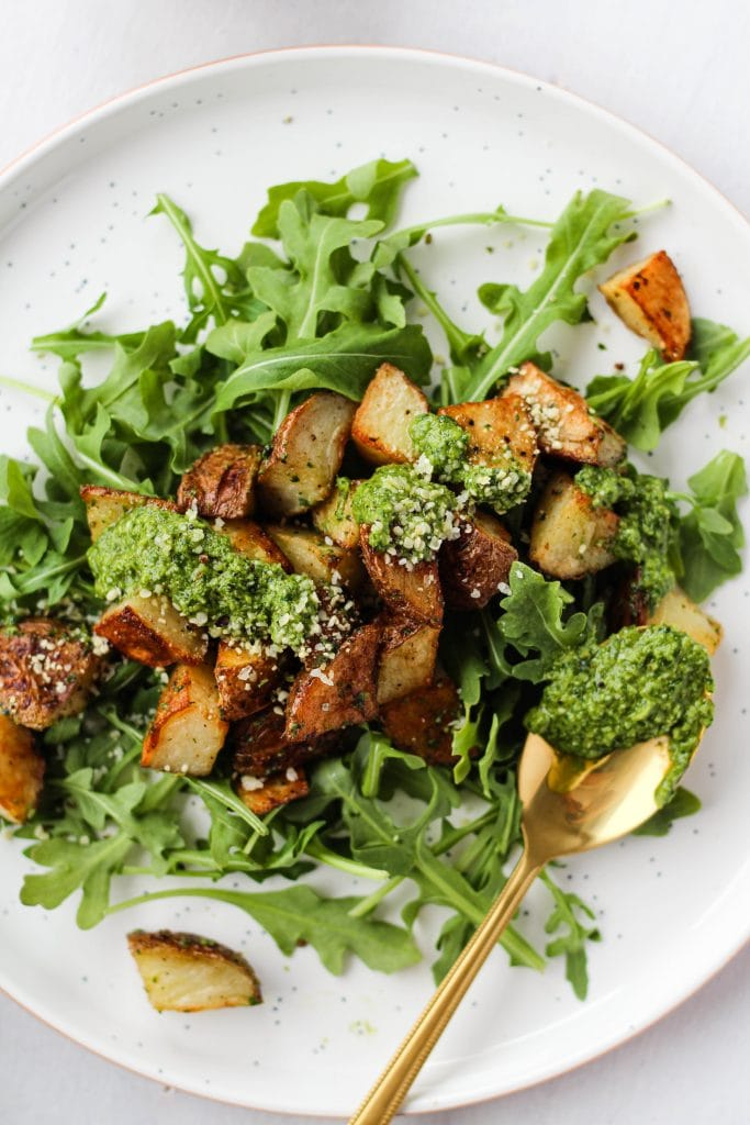 Crispy roasted potatoes tossed with creamy homemade pesto make the perfect healthy side dish for just about any meal. They're gluten-free, and can easily be made vegan.