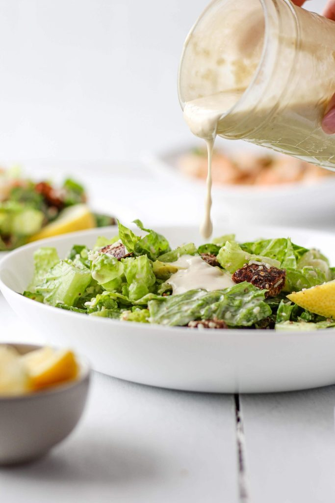 This Healthy Caesar Dressing recipe is made creamy with plain Greek yogurt. Use it for salads at home or as a dip! Make it in a blender or by hand.