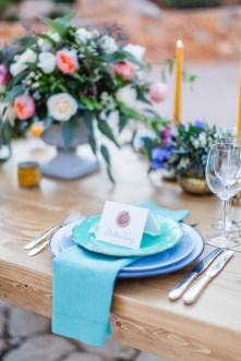 Wedding day dinner reception set up with delicate details, elegant plates, seasonal flowers and personalized place cards styled and photographed in Pyrgos Petreza Athens.