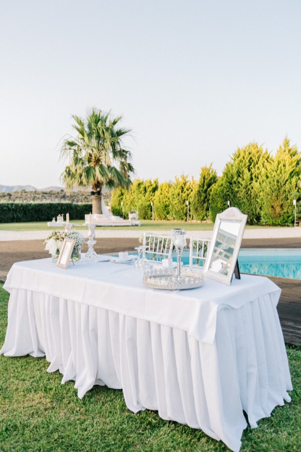 Professional wedding day image of reception location in Ktima Reveli, area of Chania Crete. Intricate luxurious detail of decorations styled and shot by a professional photographer.
