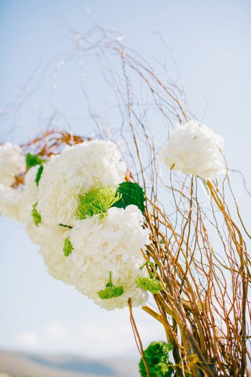 White, gold and green wedding ceremony set up in a palm tree wedding estate in Rethymno Crete.