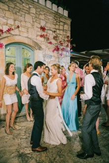Bride and groom dancing together during their wedding reception in Agreco farm estate in Crete.