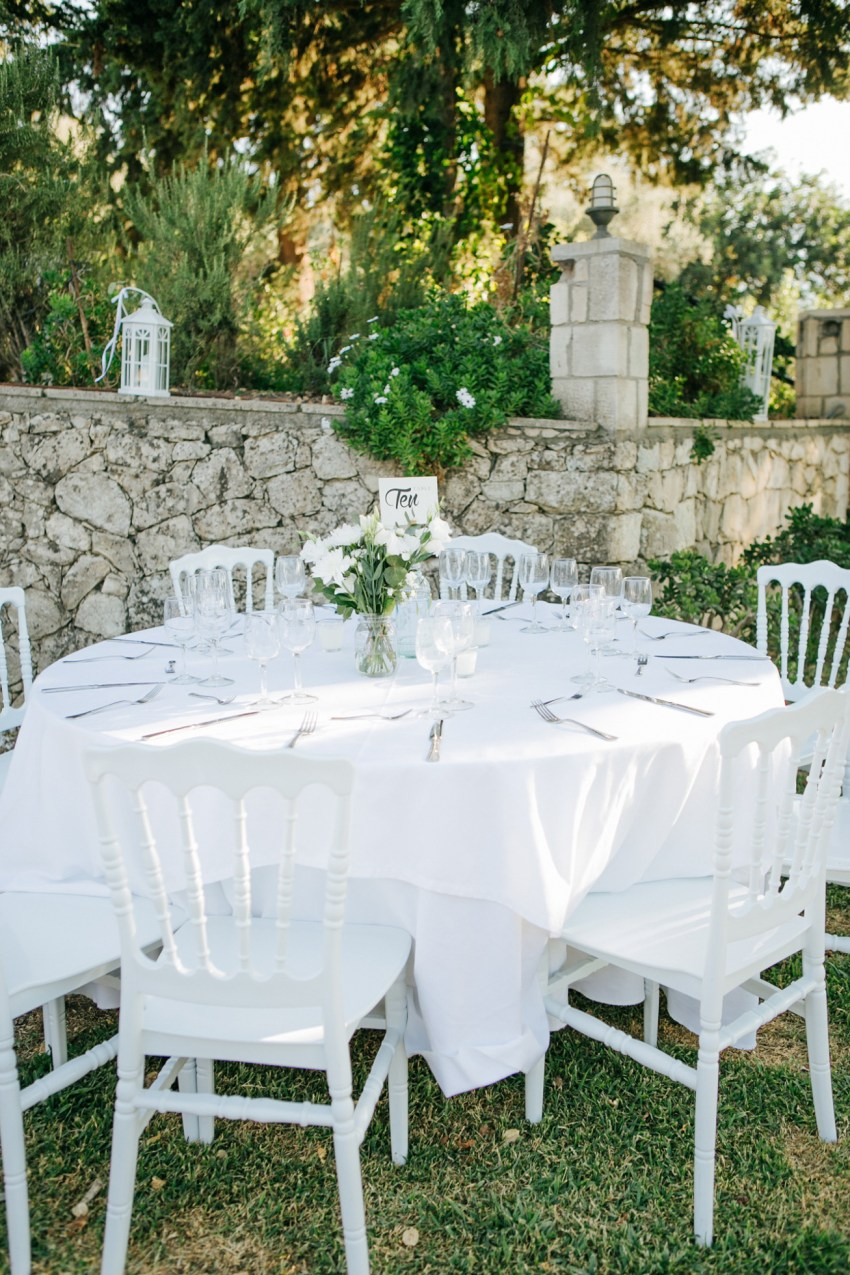 Fine art image of luxurious wedding day decoration for ceremony and reception set, styled and photographed in Dourakis winery in Chania by professional wedding photographer team.