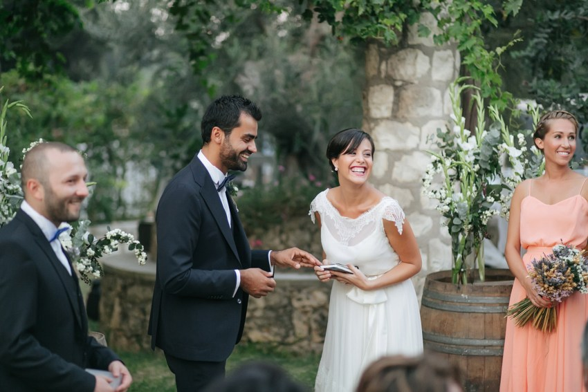 Elegant fine art photograph of a beautiful trendy couple on their wedding day, bride and groom are getting married in Dourakis winery in Chania Crete, captured by professional wedding photographer on the wedding day.