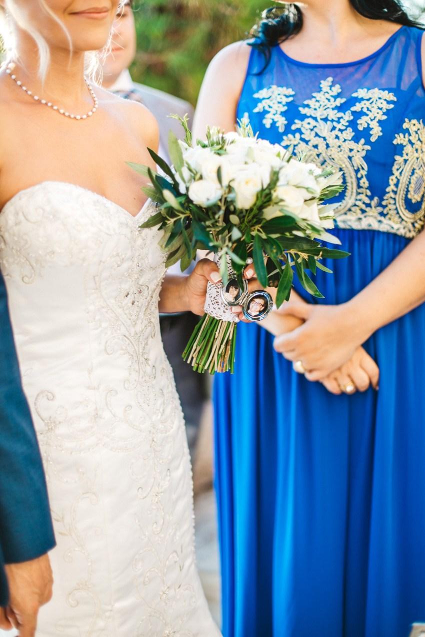 Beautiful elegant couple during their greek orthodox destination wedding ceremony in Crete, Greece.