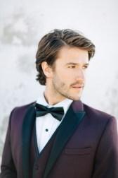Stylish modern groom at his wedding in Mykonos island, Greece.