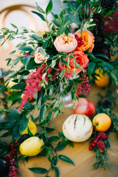 Rich and colorful table setting and flowers for a destination wedding in Mykonos, Greece.