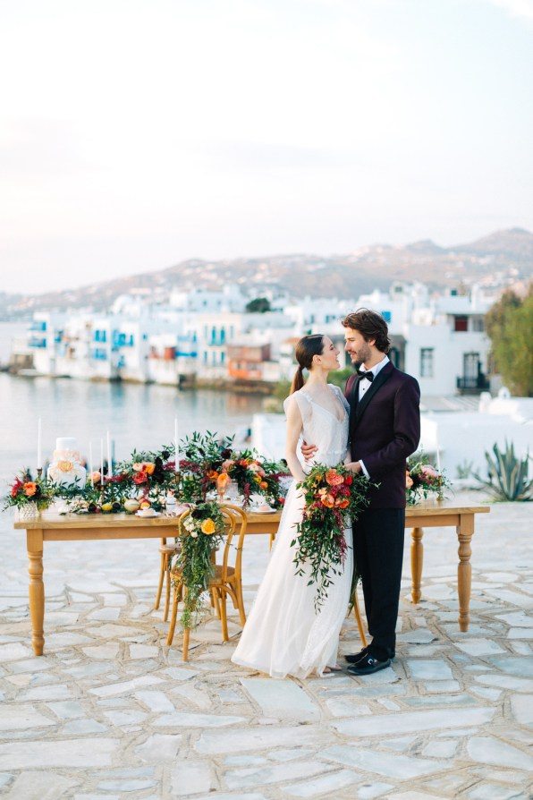 Bride and groom posing for a wedding photographer in Mykonos.