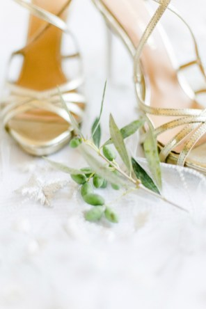 Badgley Mischka bridal shoes styled with olive branch over a Lazaro bridal veil.