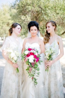 Bride with bridesmaids on a wedding day in Crete island.
