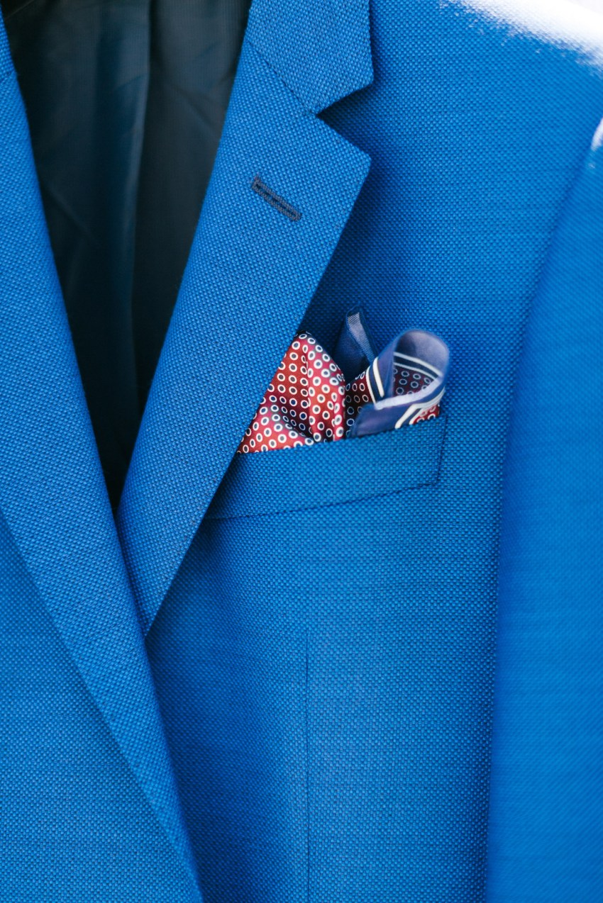 Groom's details for blue and white Santorini wedding.